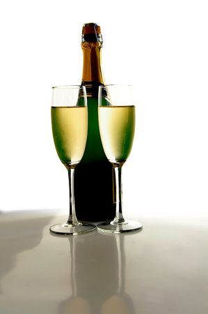 Champagne glasses and bottle on white background