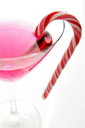 Candycane in a martini glass on white background photo