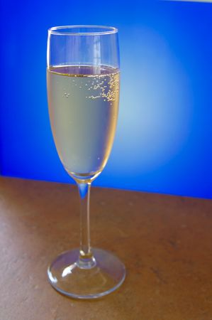 Champagne glass on blue and white background Stockfoto