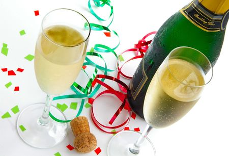 Champagne  classes, bottle and cork with colorful party ribbons photo
