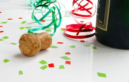 Champagne cork and colorful party ribbons photo