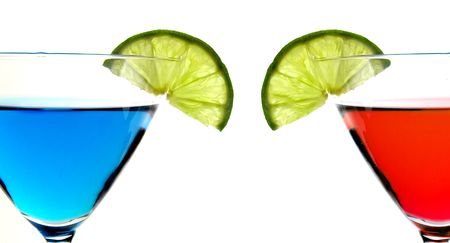 Blue Martini glass with a twist of lime on white background Archivio Fotografico