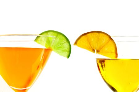 Martini glassese with a twist of lime and orange on white background Archivio Fotografico