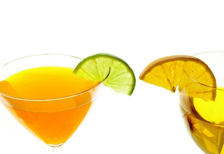 Two Martini glasses with a twist of lime and orange on white background Archivio Fotografico
