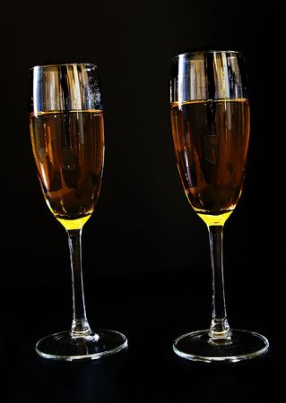 Two glaases of champagne on dark background