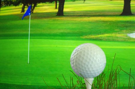 Golf ball on the tee over-looking the green Stock Photo - 717511