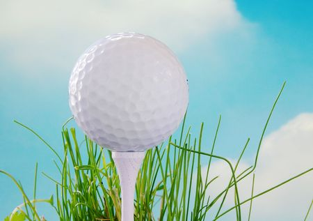 Golf ball on the tee and blue sky background Stock Photo - 717512