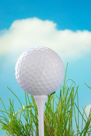 Golf ball on a tee and blue sky background Stock Photo - 717509
