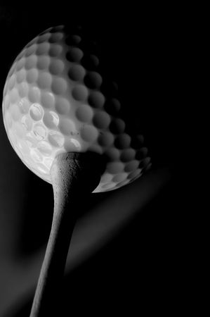 Golf ball and tee  macro in black and white photo