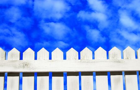 picket fence: White picket fence and blue sky