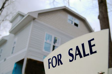 homeowner: House for sale with closeup of sign in front Stock Photo