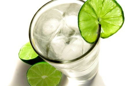 Tall glass of ice water with a slice of lime photo