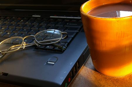 Cup of morning coffee with laptop and glasses Stock Photo - 717413
