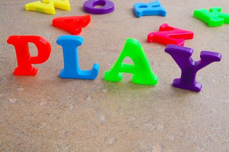 Children's colorful plastic letters spelling out
