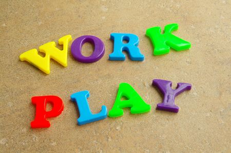 employment elementary school: Childrens colorful plastic letters spelling out Stock Photo