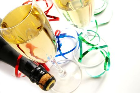 Champagne glasses and bottle on white background with ribbons