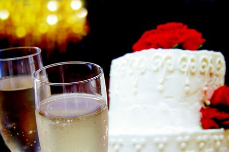 Wedding cake with flowers and champagne glasses