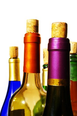rich flavor: Colorful wine bottles and corks on white