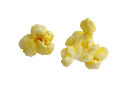 buttery: two pieces of popcorn closeup isolated on white