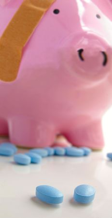 healthcare costs: Piggy bank with a bandage and pills. Healthcare costs.
