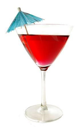 Martini glass with a paper umbrella on white background