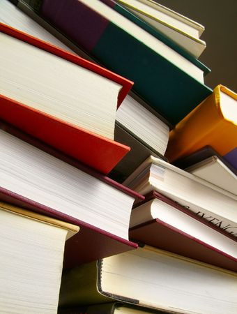Various hardcover books stacked next to each other Stock Photo - 849338