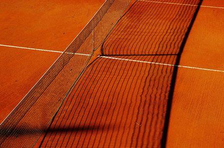 Tennis net on an outdoor clay tennis court