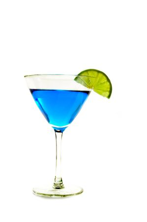 Martini glass with a twist of lime on white background