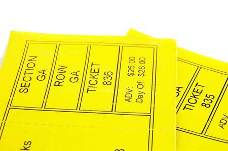 ticket stubs: Two yellow ticket stubs, closeup on white