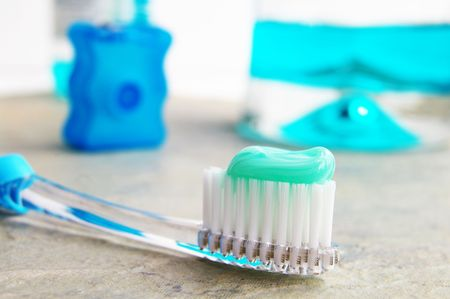 Tooth brush, mouthwash and floss Stock Photo