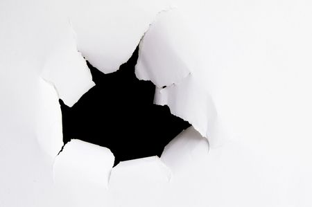Hole ripped outward in a piece of paper Stock Photo - 2614581
