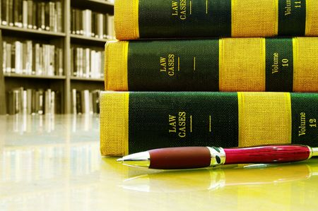 legal court: Lawbooks stacked with pen, in a library Stock Photo