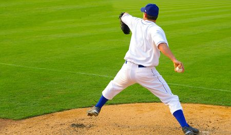 Professional baseball pitcher throwing the ball photo