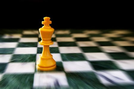 loss leader: King on a chess board, against black background