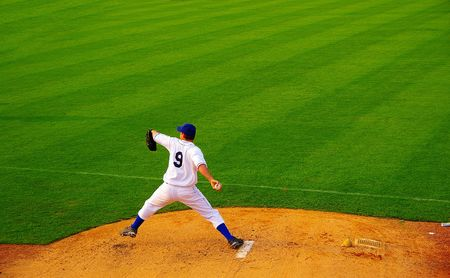 Pro baseball  pitcher throwing the ball from the mound photo