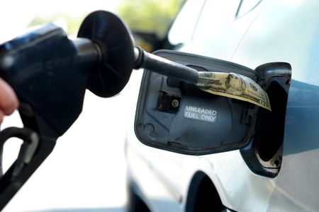 gas pump: Putting money into the tank (high gas prices) Stock Photo
