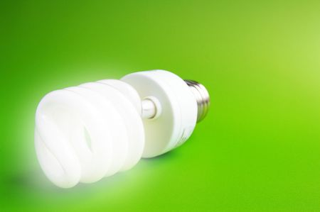 Compact fluorescent light bulb on green (green energy) Stock Photo - 2774008