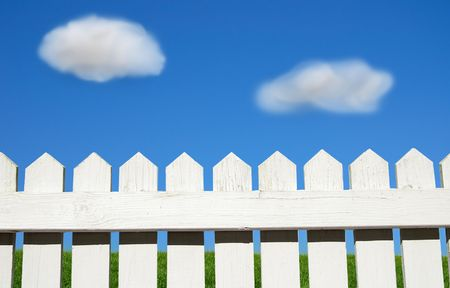 White picket fence, green grass and sky Stock Photo - 2827105