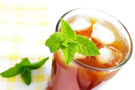 iced tea: Glass of iced tea with mint leaves, from above