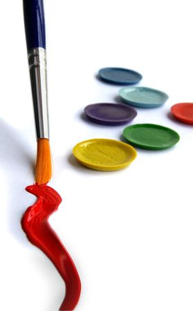 differ: Paint brush, red paint,  and paint pallet closeup Stock Photo