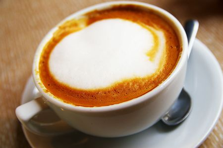 frothy: Closeup of a cup of  frothy cappuccino coffee Stock Photo