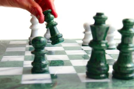 Chess player moving a piece, isolated on white Stock Photo - 3125978