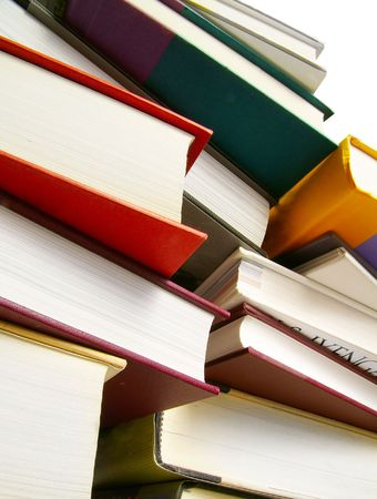 Various hardcover books stacked next to each other Stock Photo - 3303475