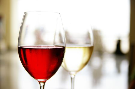 glass of red and white wine at a restaurant Stock Photo