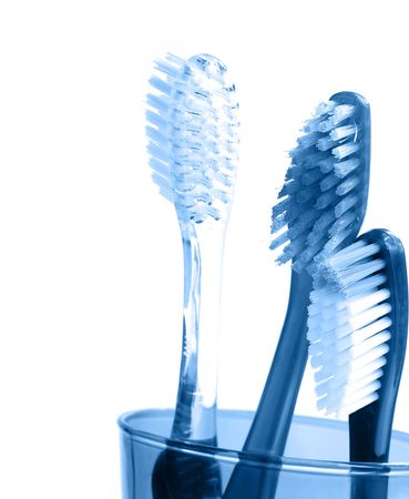 Three tooth brushes, closeup isolated on white