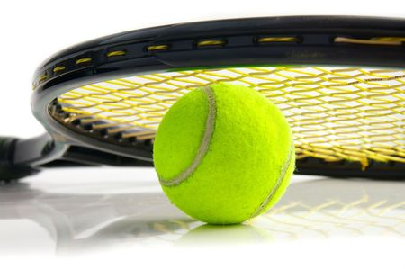 closeup of a tennis ball and racket, on white