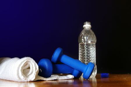 Workout equipment ( water bottle, weights and towell) Stock fotó