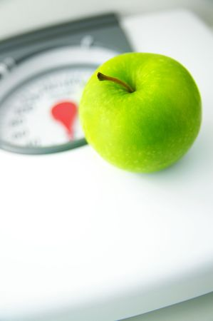 green apple sitting on a bathroom scale Stock Photo - 3442960