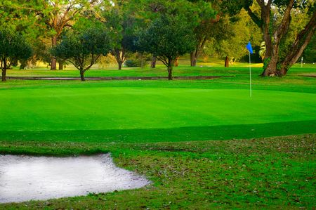 Golf green and sand trap, with flag  stick Stock Photo - 3511797
