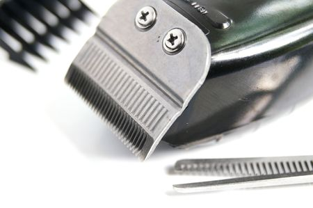 closeup of hair clippers and accessories, on  white photo